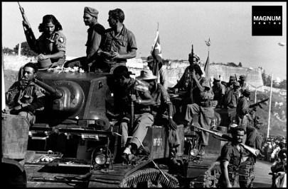 CUBA. La Havana. 1959. Fidelistas ride liberated tanks into La Havana to accompain Castro on his entry into the city. ©BurtGlinn/Magnum