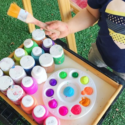 Invitation to Paint on an Upright Easel Outdoors with a Rainbow Assortment of Colours – Day 22/31 Days of Invitation to Create Challenge