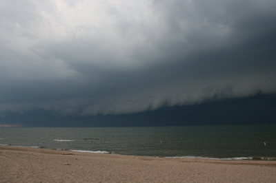 An arcus cloud advances toward the Lake Michigan shoreline at Allegan Beach.