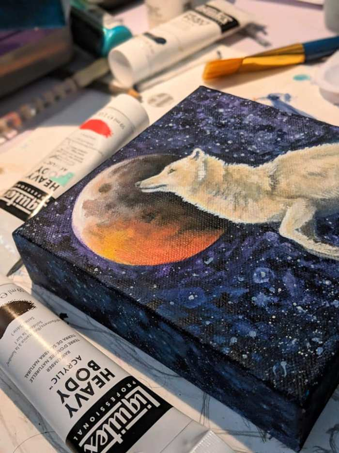 Acrylic painting of wolf with moon and eclipse