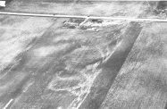 Deep cycloidal scour marks east of Greentown, left by an intense suction vortex which swept away a home at top center.