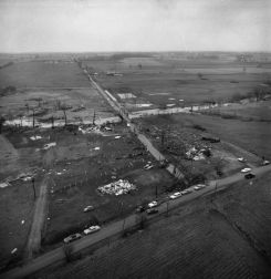Aerial view of the destruction at Middlebury. A Mrs. Ed Nihart was killed in a car thrown from CR-10 (upper arrow), and a Mrs. Lester Miller was killed when her home was demolished (lower arrow).