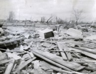 A dozen homes were completely leveled on the south side of Glazier. Here, one man picks through the rubble of his home. At right is the bathtub in which he rode out the storm.
