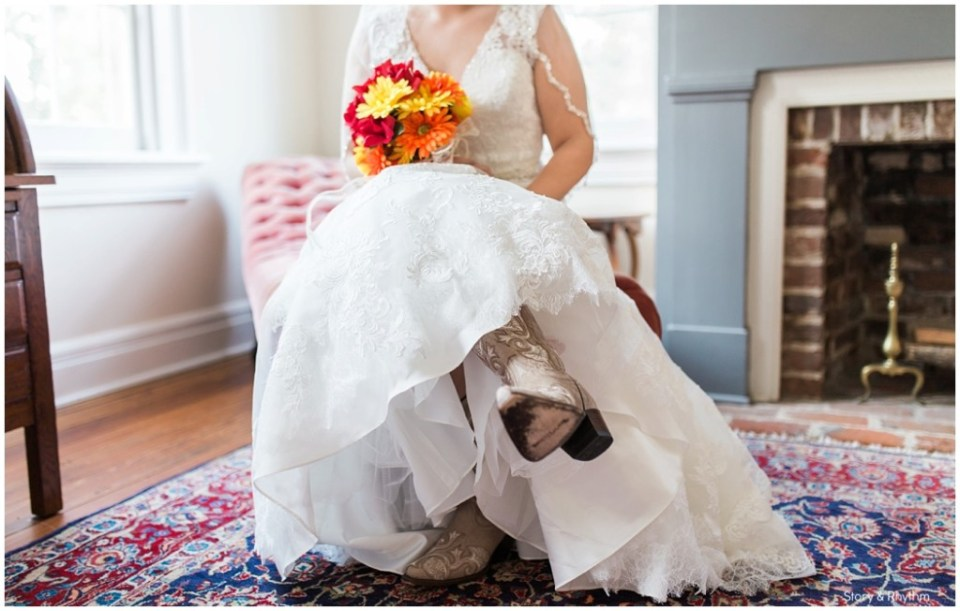 Bride wearing cowboy boots with a lace wedding dress