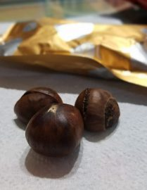 Unpeeled, ready-to-eat roasted chestnuts.