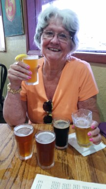 Mimi enjoying her beer flight at one of our lunches on SPI.