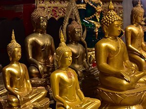 Statues inside Tiger Cave Temple Krabi Thailand