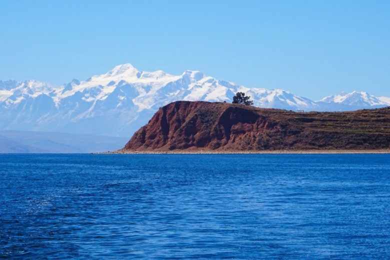 Lake Titicaca Bolivia style: Isla de la Luna against the backdrop of snowy mountains