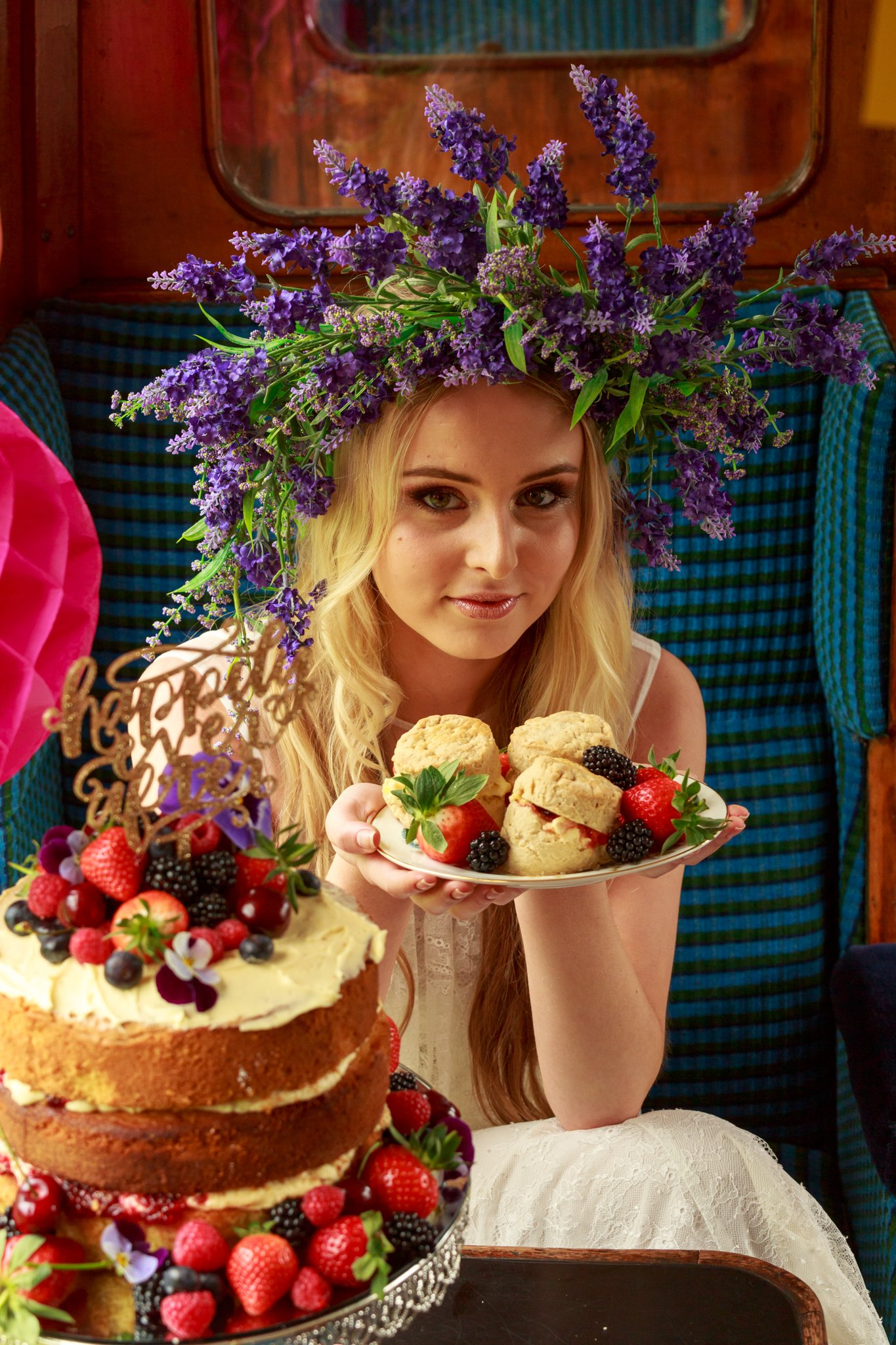 Model Indie poses with cakes