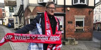 A man selling scarves in Ashbourne on the two days of Shrovetide. Photo: John Grant