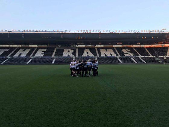Derby County team huddle