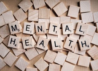Pictured is the word 'mental health' made out of tiled letters