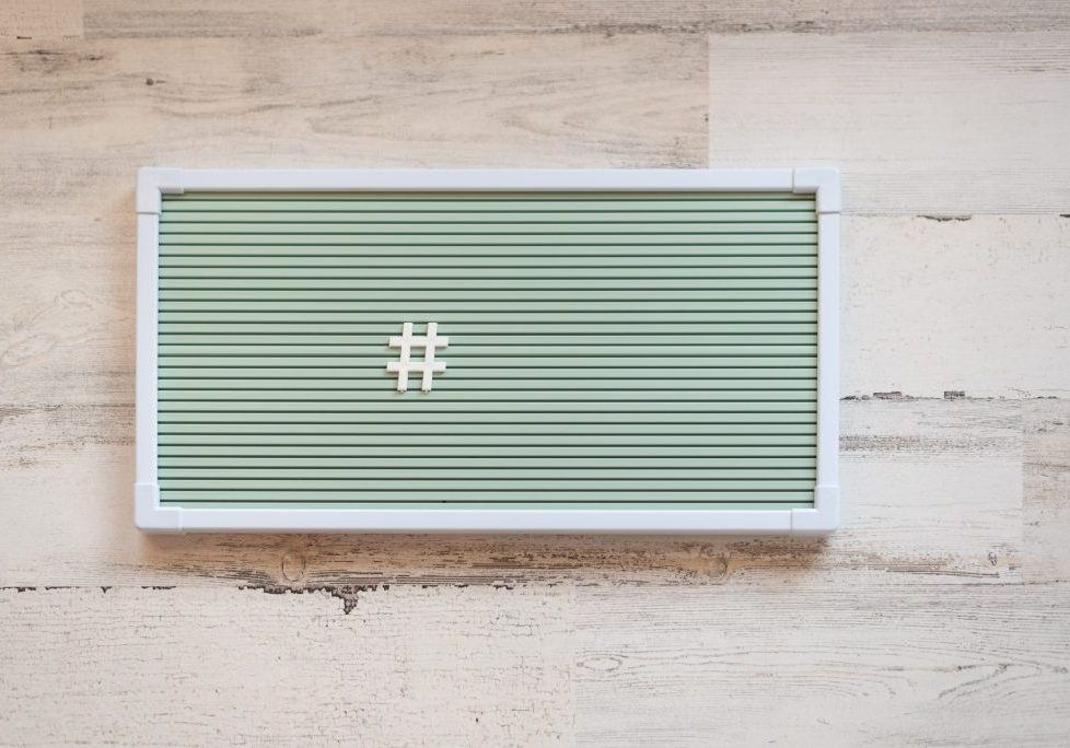 Hashtag on blank green letterboard