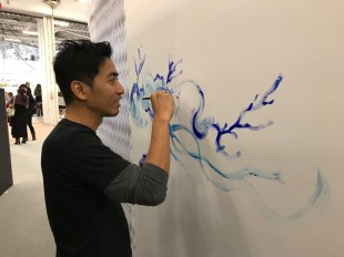 Indonesian illustrator Emte creates his artwork at the Indonesia stand.