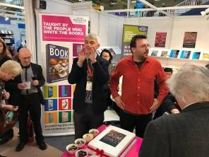 Angus Philips makes an announcement at the Oxford Brookes stand.