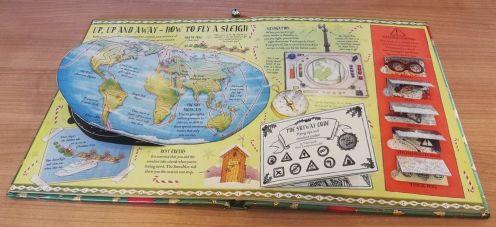 Santa's Christmas Handbook - globe - Story Snug