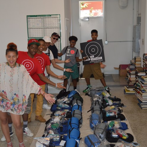 Teens put together resource backpacks for transient youth.