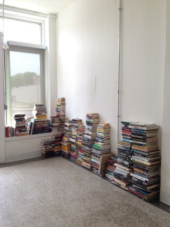 616 N Skinker Stitchers Storefront Studio with books donated by West County Book Fair
