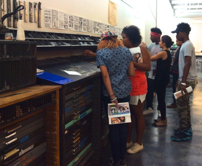 Mariana Parisca, BFA'15, leads Stitchers Teen Council members on an admissions tour of the Sam Fox School of Design and Visual Arts studios. Photo Susan Colangelo. August 12, 2015