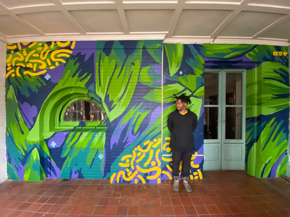 Javyn Solomon with Loutopia Mural, image courtesy of Loutopia