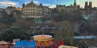 The Christmas market with Old Town in the background - Edinburgh travel tips