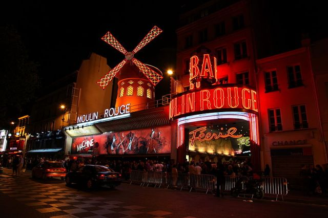Shades of the World Series: Red lights lighting up Le Moulin Rouge at night