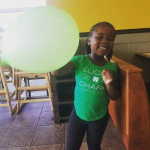 girl playing with a balloon