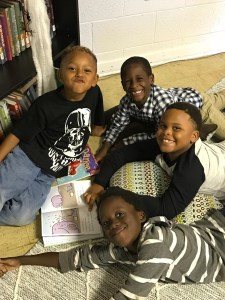 kids from STORY reading books