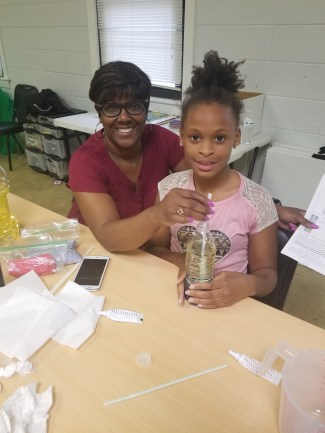 mentor with her mentee doing a science experiment