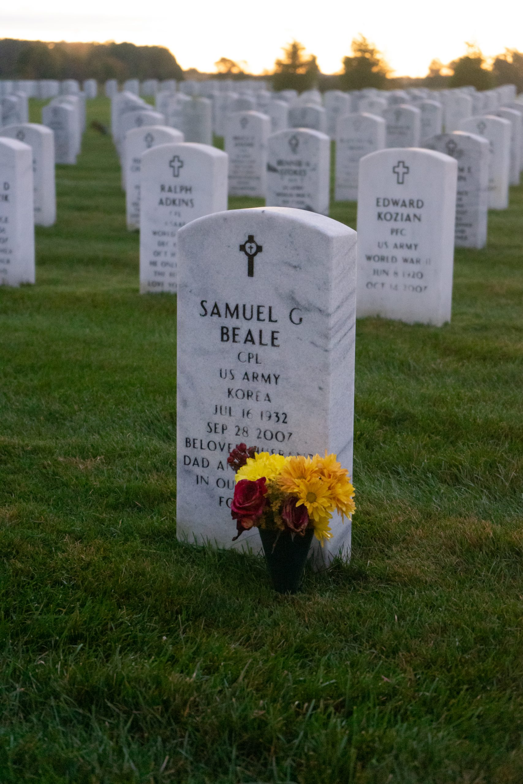 A headstone with flowers at the Great Lakes National Cemetery