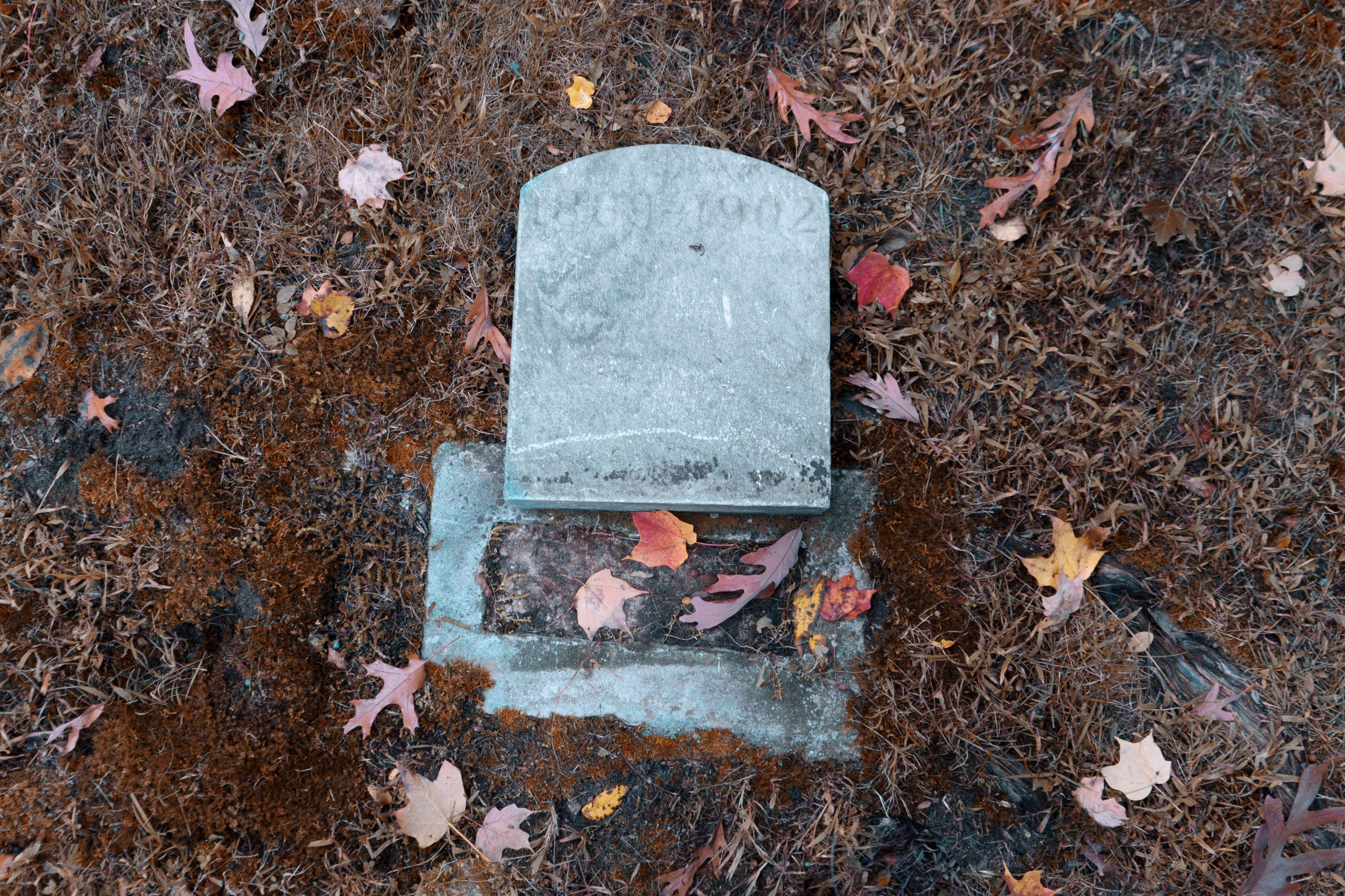 A fallen headstone in Lakeside Cemetery