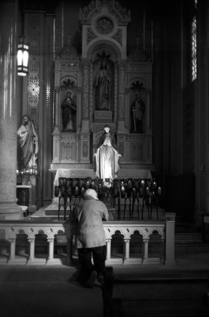 Man praying in Old St. Mary's Catholic Church on JCH Streetpan 400