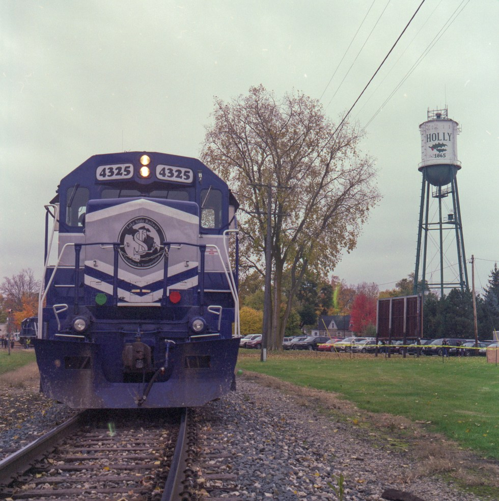 A train in front of the Holly water tower on Fuji Pro 400H 120 film