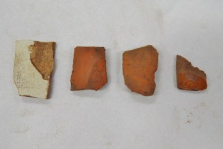 The pottery sherds found in the first bag of artifacts from SU 1211.