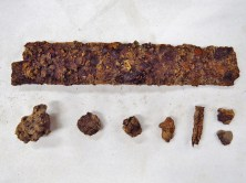 The various metal and clinker pieces found in the first bag of artifacts from SU 1211.