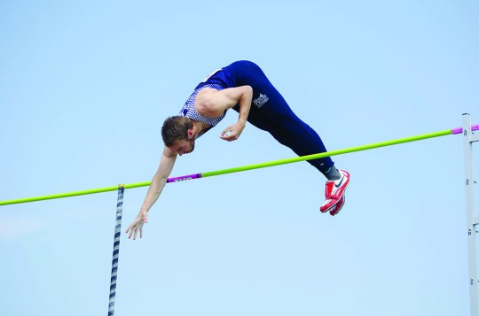 Christian Lucchesi (Jr, Milwaukee, Wis.) competing in the pole vault at the WIAC championships in Whitewater, Wis.