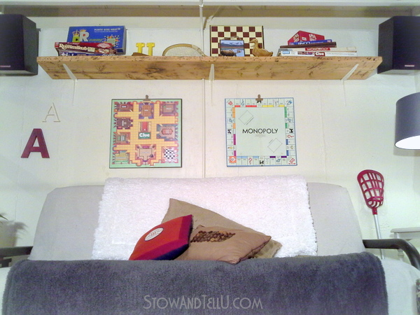 game-room-decor-over-the-couch-shelf-vertical-storage-space-saver-http://stowandtellu.com