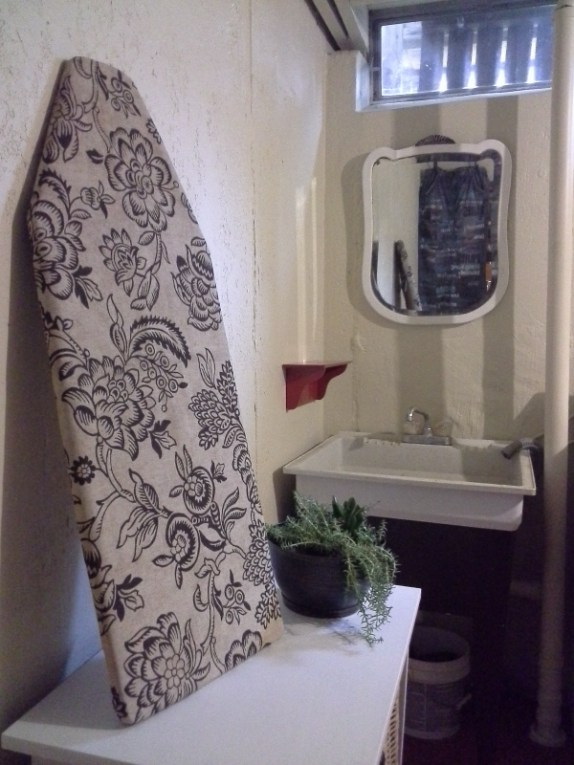 """diy 1 hour hand sewn ironing board cover is part of basement laundry room updated done almost exclusively with paint, several diy repairs and a """"use what you have"""" approach from Stow and Tell U"""
