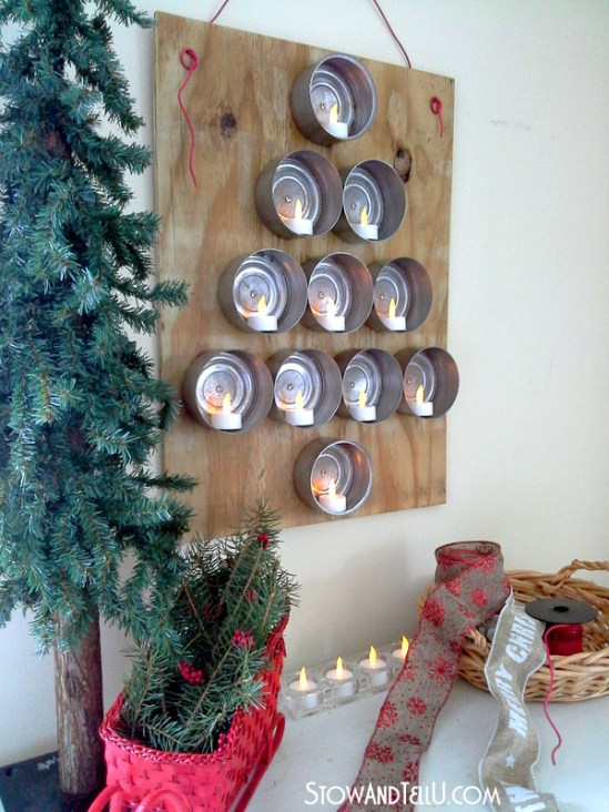 Use large tuna or chicken cans to make a hanging Christmas tree that you can light up with flameless tealights from Stow and Tell U