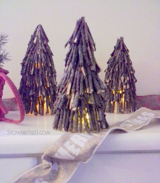 Create a rustic twig Christmas tree for holiday decor or centerpieces with twigs, a clear plastic cup and hot glue from Stow and Tell U