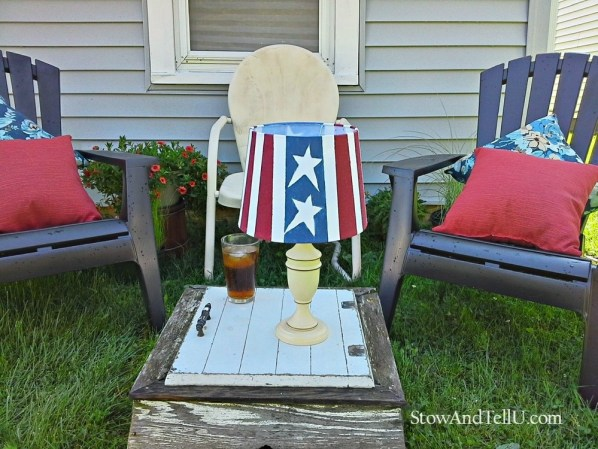 Upcycled table lamps are painted to look like the American flag and turned into patriotic outdoor solar lamps - Fourth of July solar lamps - StowAndTellU.com