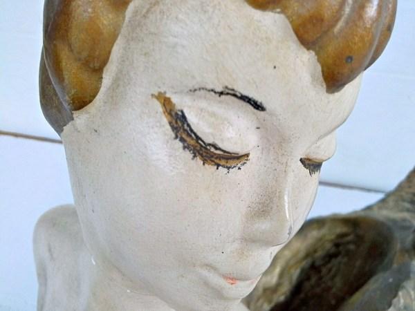 vintage mermaid statue face