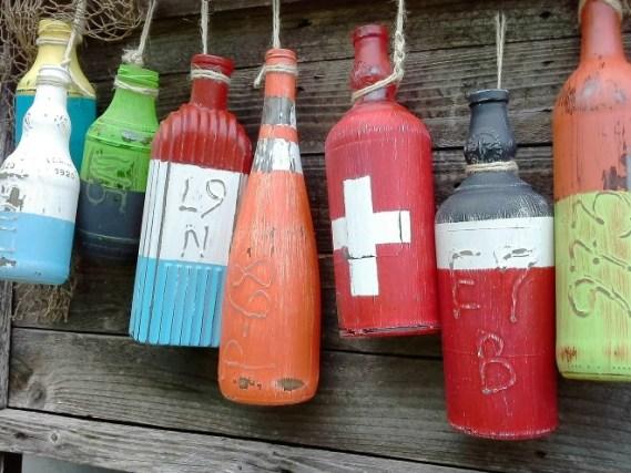 10 Best Crafty Reuses for bottles - faux nautical fishing buoys | StowandTellU.com