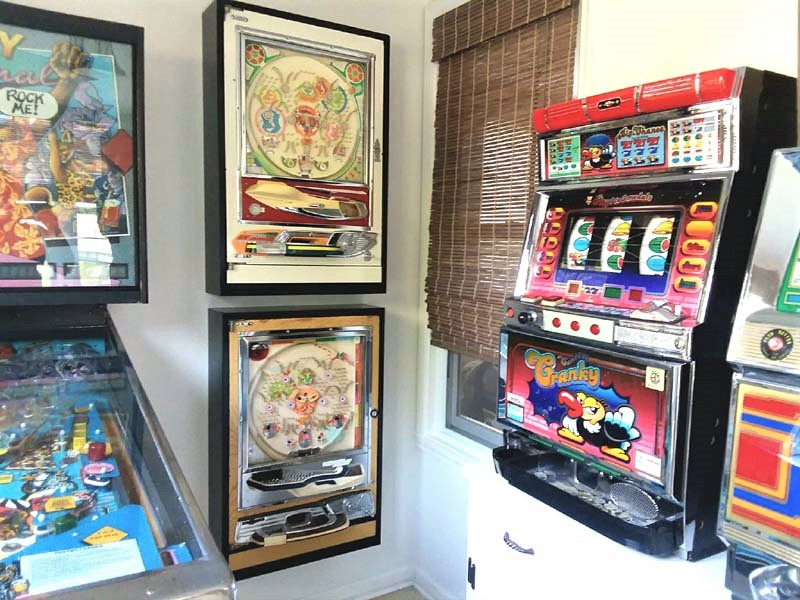 Small Arcade Room with French Cleat Mounted Pachinko Cabinets | stowandtellu.com