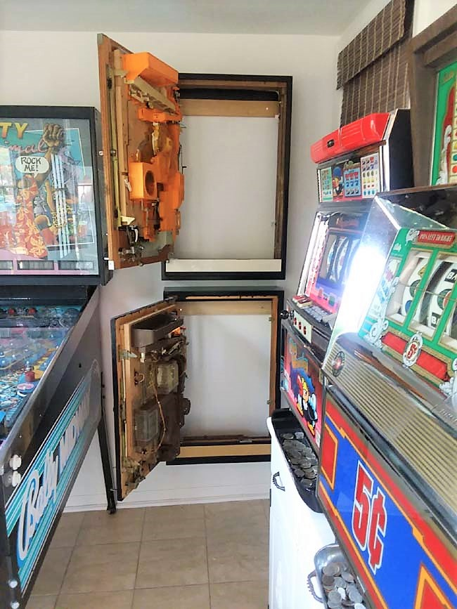 Diy French Cleat Mounted Pachinko Cabinets in Small Game Room | How to hang pachinko machines on the wall | stowandtellu.com