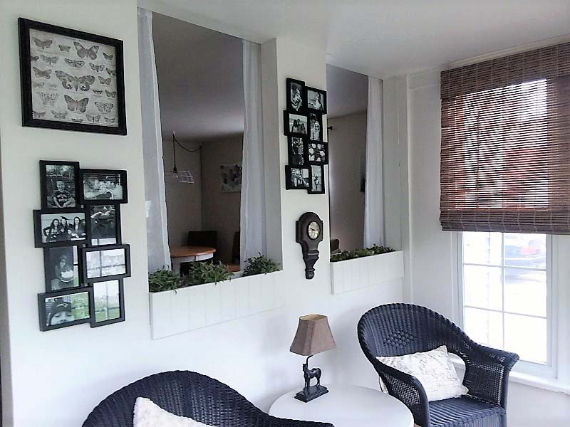 Gallery Wall in Small Sun Porch Sitting Area Makeover