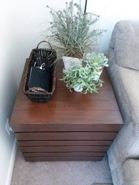 Basket Phone Charger and plants on dark stained table top