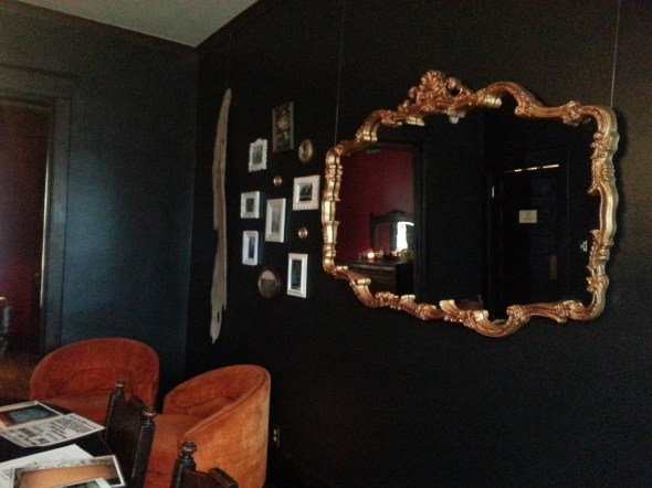 black walls gold mirror