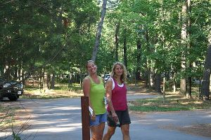 Renee and Leslie walking in the woods