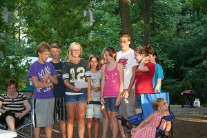 Kids lead us in song at summer worship service